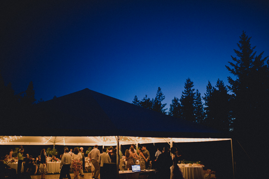 Outdoor wedding reception under a tent